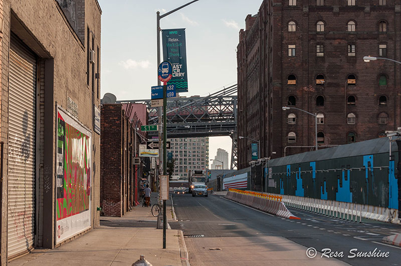 The old Domino sugar factory on the right and a glimpse of the Williamsburg Bridge